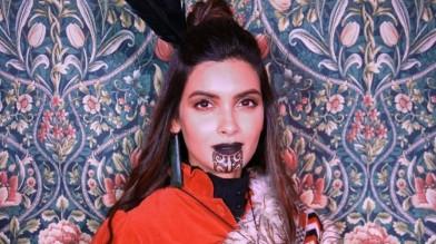 Diana Penty in the style of a Maori ancestor