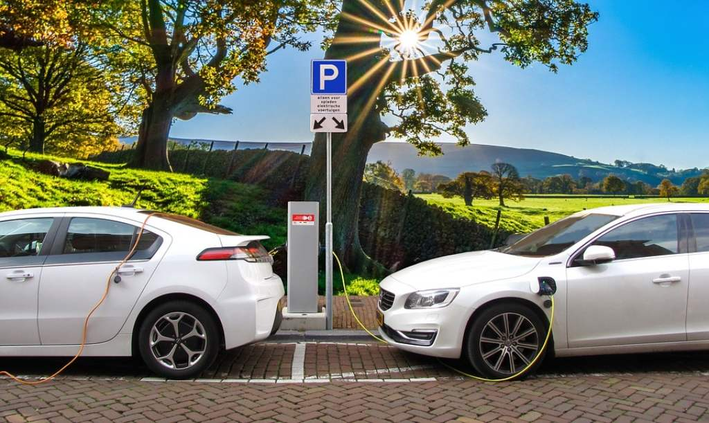 Representational Picture Of Hybrid Cars Being Charged At The Charging Station 2